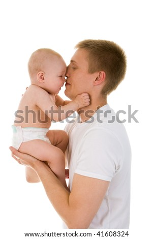 Portrait of loving father and his baby cuddling - stock photo