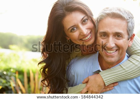 Portrait Of Loving Hispanic Couple In Countryside
