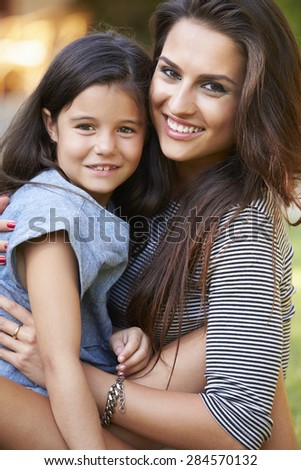 Portrait Of Loving Mother And Daughter In Garden - stock photo