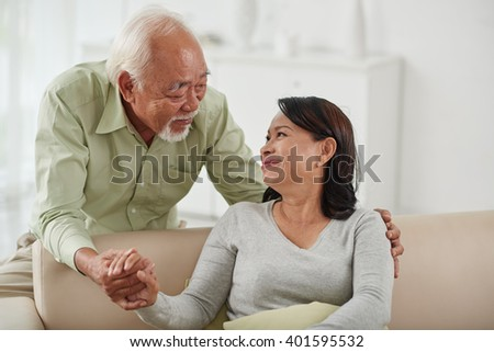 Portrait of loving senior couple at home
