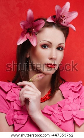 Portrait of luxury woman in pink evening dress and flowers in her hair. - stock photo