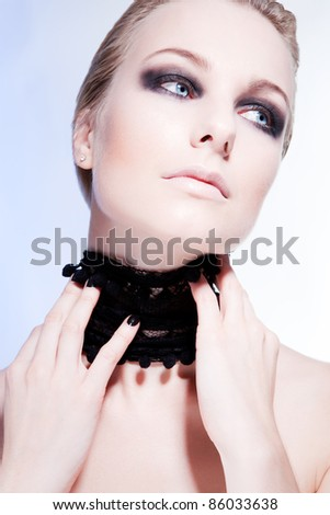 Portrait of luxury woman model with dark fashion evening smoky make-up.
