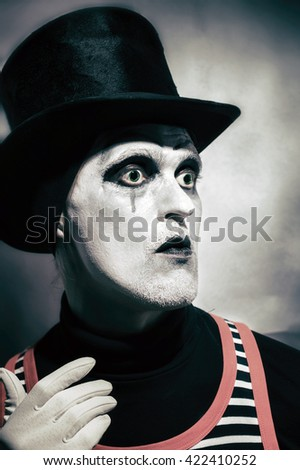 Portrait of mad hatter dressed in black topper on white background