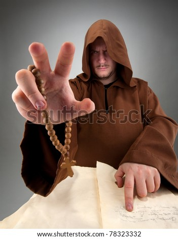 Portrait of magician reading the spell from old book - stock photo