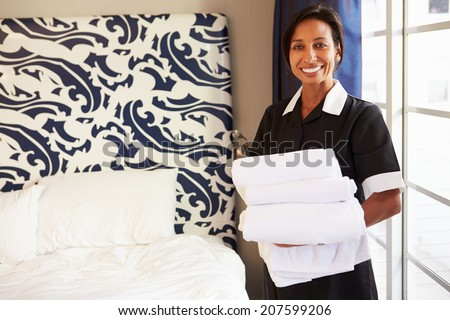 Portrait Of Maid Tidying Hotel Room - stock photo