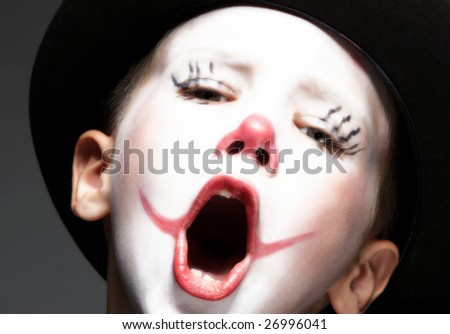portrait of make up clown boy with red nose - stock photo