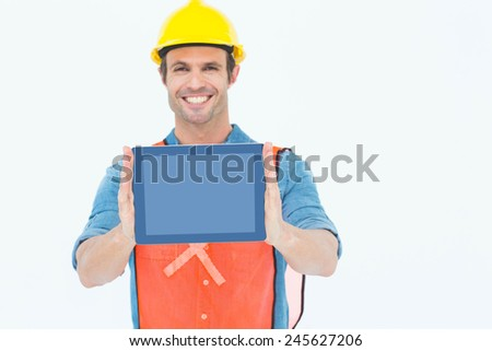 Portrait of male architect holding digital tablet over white background - stock photo