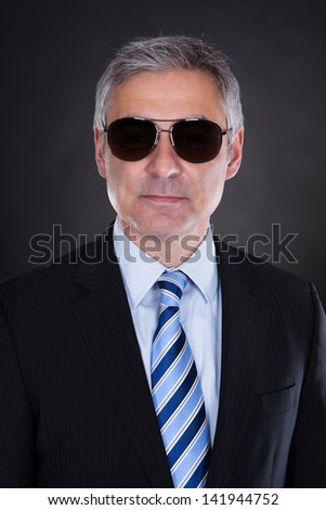 Portrait Of Male Body Guard Over Black Background - stock photo