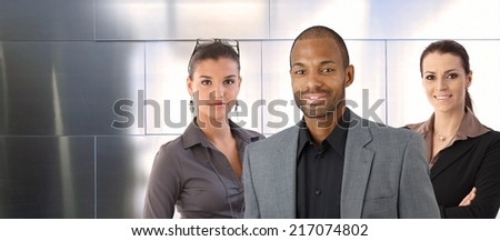 Portrait of male boss and female team, smiling. - stock photo