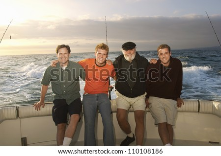 Portrait of male Caucasian friends on yacht - stock photo