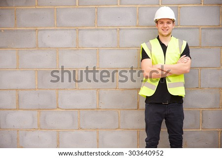 Portrait Of Male Construction Worker On Building Site - stock photo
