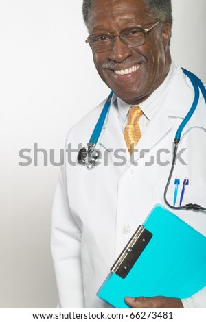 Portrait of male doctor - stock photo