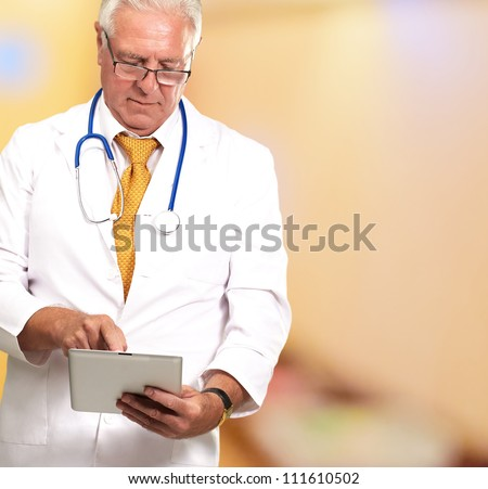 Portrait Of Male Doctor Working On A Tablet, Background - stock photo