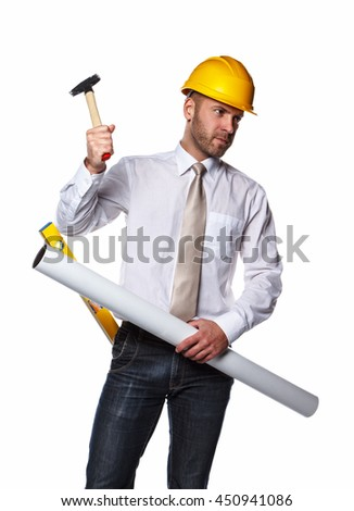 Portrait of male in yellow safety helmet holding drawning tube, hummer and industry level.