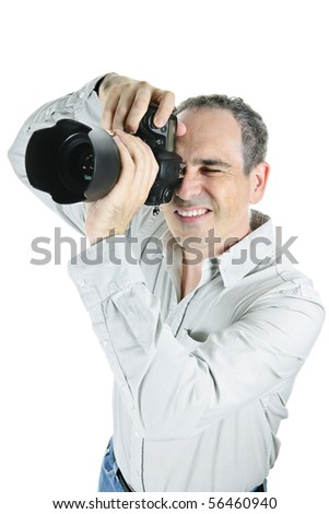 Portrait of male photographer with camera isolated on white background - stock photo