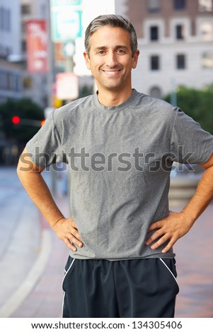 Portrait Of Male Runner On Urban Street