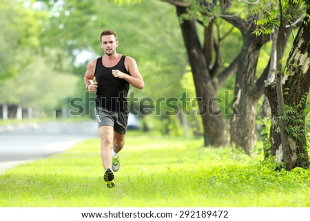 portrait of male runner training for marathon with copy space - stock photo