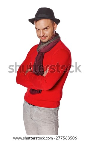 Portrait of male standing with folded hands stared with brooding eyes, looking at the camera - stock photo