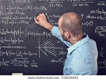 portrait of male teacher at work - stock photo