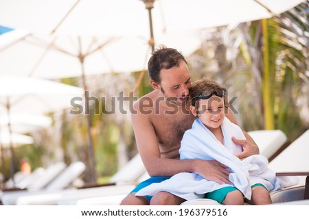 Portrait of man and his son after swimming in the pool - stock photo