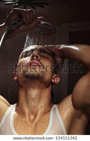 Portrait of man bathing in bathroom - stock photo