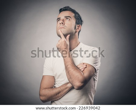 Portrait of man being doubtful about something - stock photo