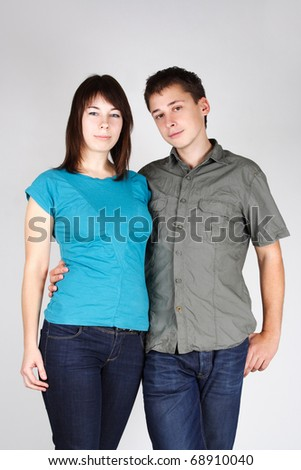 portrait of man embracing brunette girl and looking at camera - stock photo