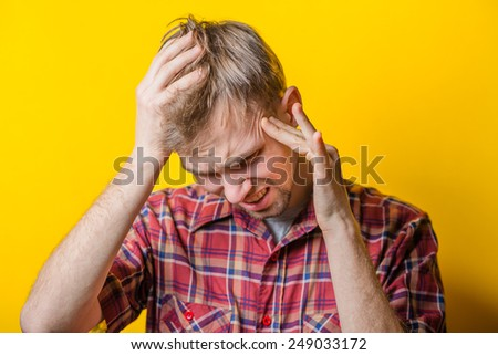 Portrait of Man Holding His Head in Stress - stock photo