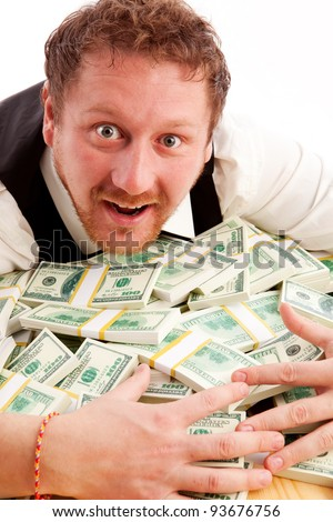 portrait of man hugging bundles of money isolated on white - stock photo