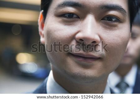 Portrait of man in a parking garage, close-up, Beijing - stock photo