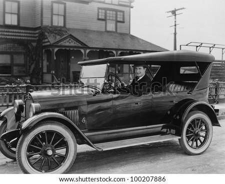 Portrait of man in car - stock photo