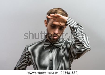 portrait of man in despair - stock photo