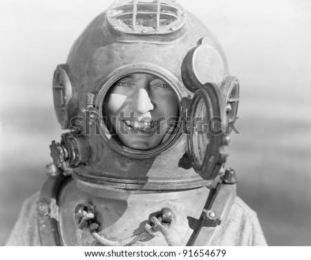 Portrait of man in diving helmet - stock photo