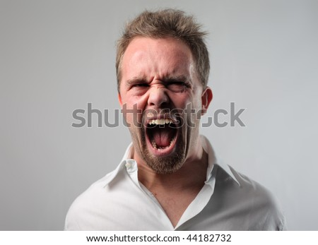 portrait of man in extreme rage - stock photo