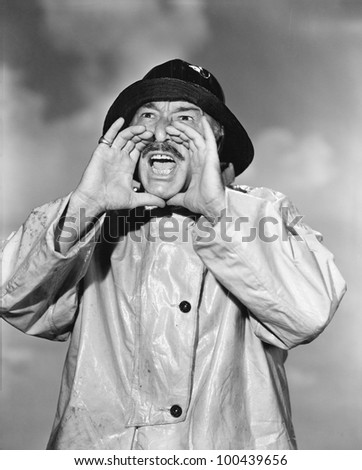 Portrait of man in raincoat yelling - stock photo