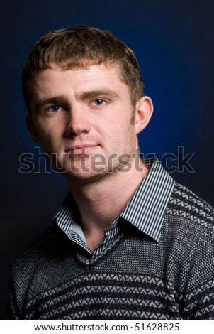 portrait of man on black background - stock photo