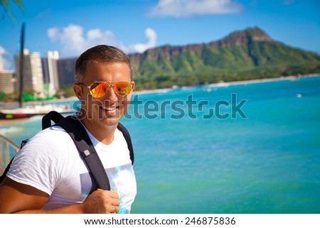 Portrait of man on travel vacation holidays on Hawaiian Waikiki beach with Diamond Head. Vacations And Tourism Concept. Summer luxury vacation in Hawaii. - stock photo