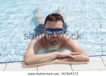 Portrait of man relaxing in a swimming pool