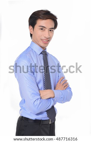 Portrait of man standing with crossed arms â??white background