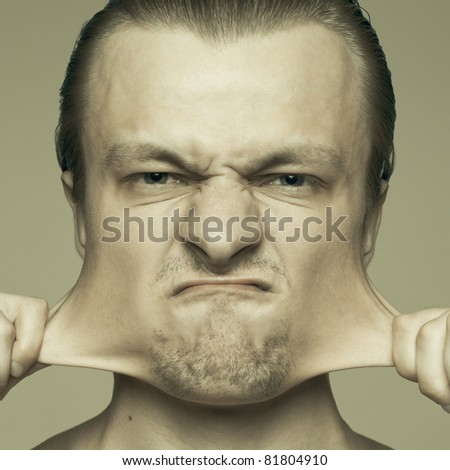 portrait of man stretching out his cheeks