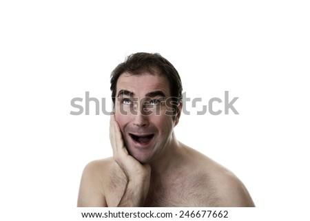 portrait of man taken in the studio looking surprised - stock photo
