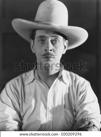 Portrait of man wearing cowboy hat - stock photo