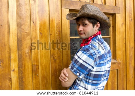 Portrait of man wearing cowboy hat, silk scarf, and checked shirt. Photo is taken in Calgary during Stampede - stock photo