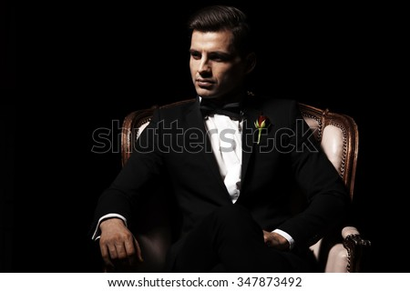 Portrait of man who sitting on chair, godfather-like character.   - stock photo