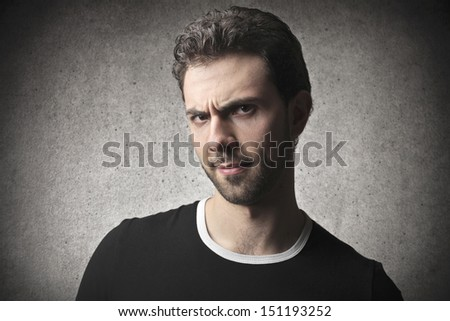 portrait of man with a grudge - stock photo
