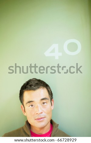 Portrait of man with number 40 above his head