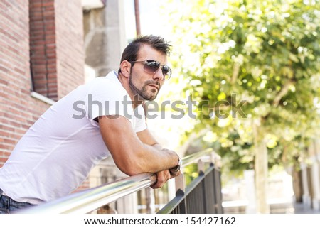 Portrait of man with sunglasses.