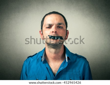 portrait of man with the taped mouth - stock photo