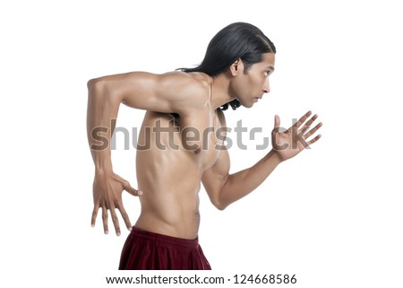 Portrait of masculine guy in running gesture against white background - stock photo