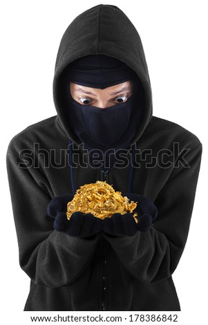 Portrait of masked man is holding stolen gold. isolated on white background - stock photo